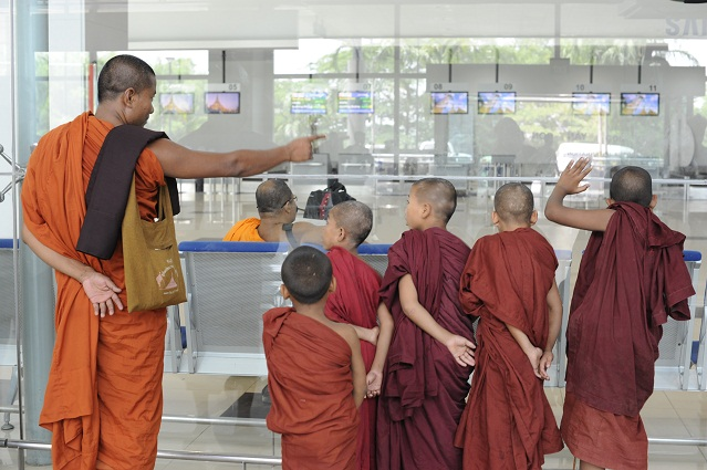 monks at the airport